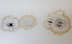 water stains and damage on ceiling from leaking roof