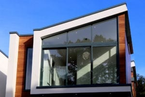 Modern house with black frame replacement windows