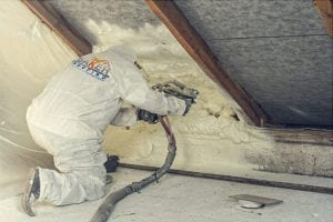 Foam Insulation being sprayed by Baker Roofing & Construction