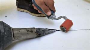 Sealing a TPO seam with hot air weld