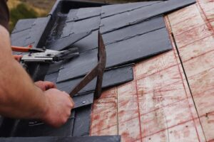 Slate roof being installed on house